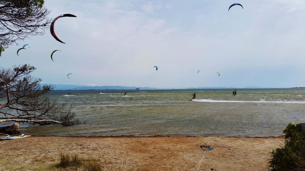 Punta Trettu Kitesurf Paradise in Sardinia: flat hallow water Steady wind, perfect conditions for kitesurfing